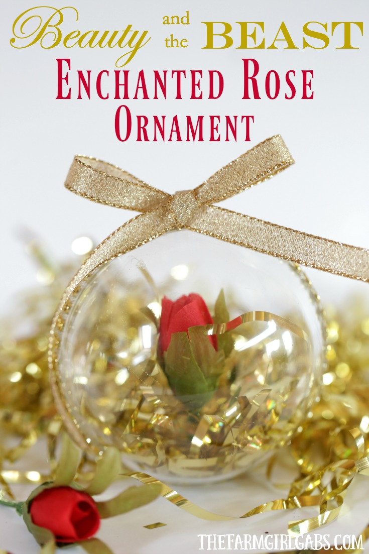 Make a Beauty & the Beast Enchanted Rose Christmas ornament using a plastic ball, rhinestones, ribbon and the ROSE!  Super easy to follow instructions from Melissa of